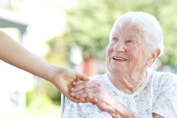 old woman shaking hands